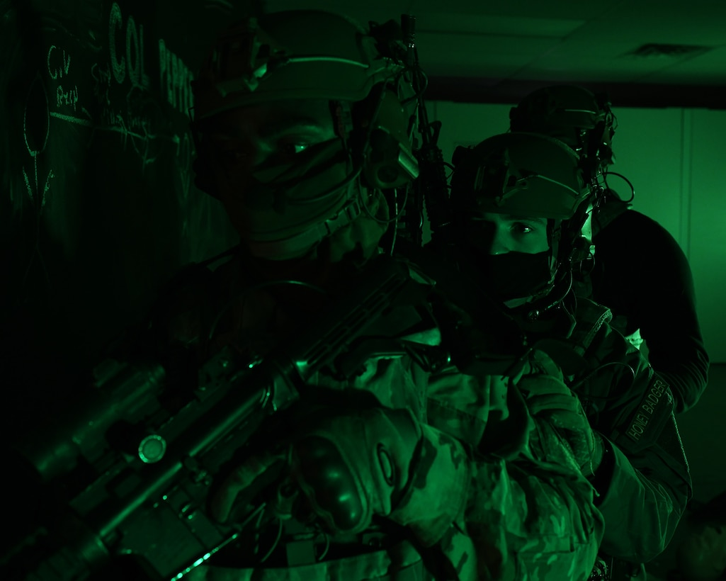 Airmen from the 460th Security Forces Squadron stand guard at a door during a training exercise at Buckley Air Force Base, Colo., Feb. 17, 2021. During the training, the Defenders refreshed their Tactical Combat Casualty Care with the Aurora Special Weapons and Tactics Team before going through the shoot house to apply what they learned. (U.S. Space Force photo by Airman 1st Class Haley N. Blevins)