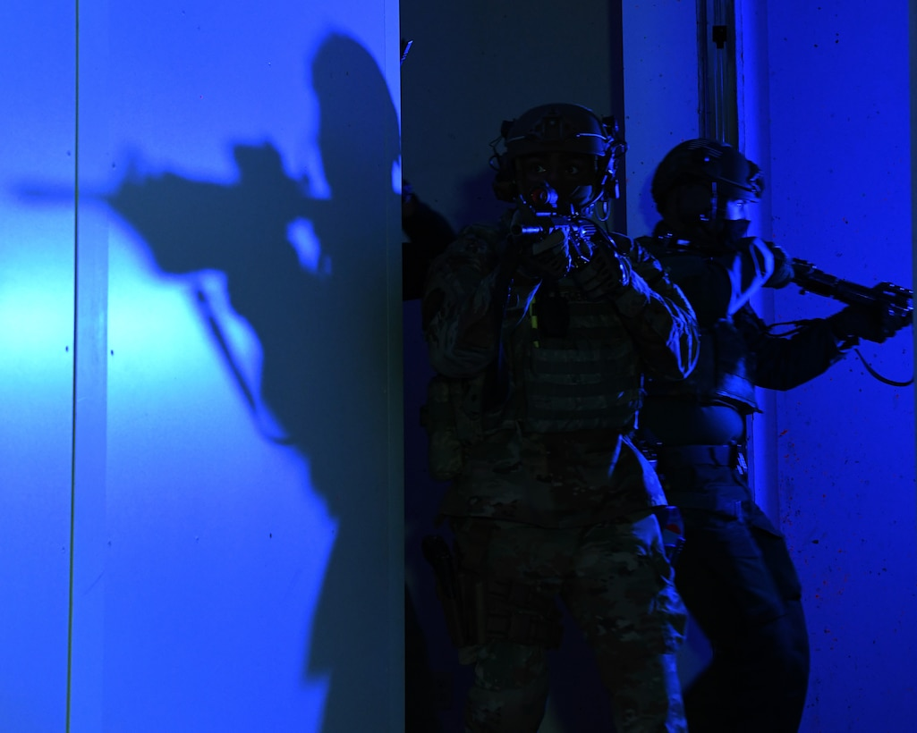 Airmen from the 460th Security Forces Squadron sweep a room in the shoot house at Buckley Air Force Base, Colo., Feb. 17, 2021. The 460th SFS ran through multiple scenarios in the shoot house alongside the Aurora Special Weapons and Tactic Team. (U.S. Space Force photo by Airman 1st Class Haley N. Blevins)