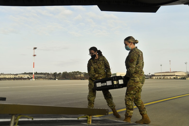 U.S. Air Force Airmen with the 1st Combat Communication Squadron load a Flexible Communication Package onto a U.S. Air Force C-17 Globemaster III during a Combined Joint All-Domain Command and Control demonstration at Ramstein Air Base, Germany, Feb. 22, 2021.