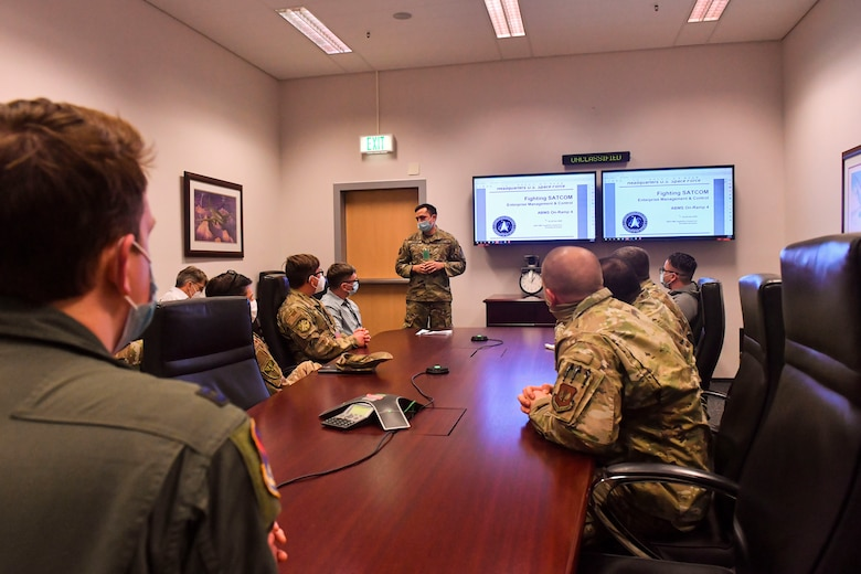 U.S. Space Force 1st Lt. Raphael Darras, enterprise management and control project officer, provides a satellite communications demonstration during a Combined Joint All Domain Command and Control Demonstration at Ramstein Air Base, Germany, Feb. 24, 2021