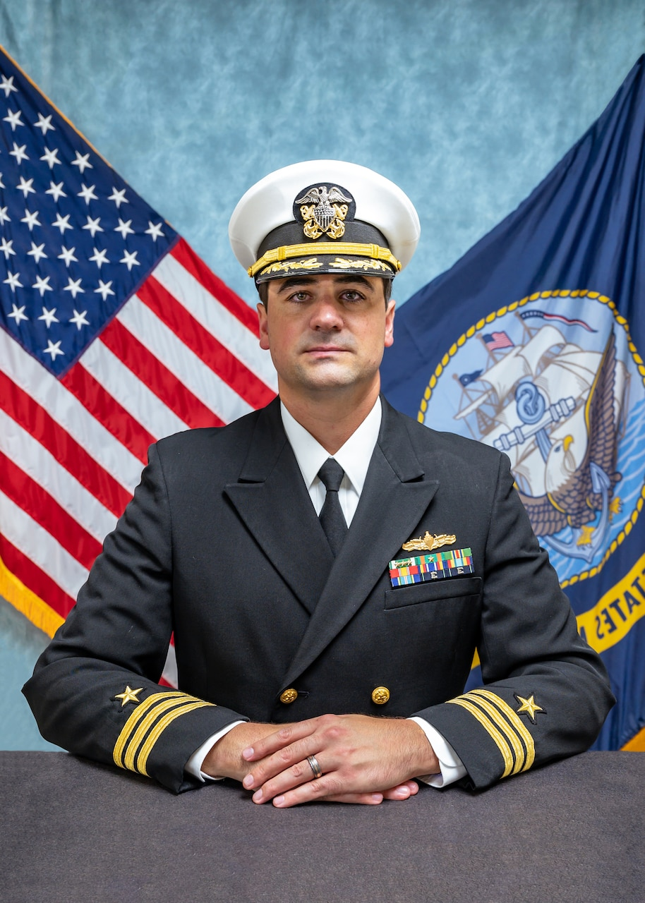 Studio portrait of Cmdr. Eric K. Rolfs