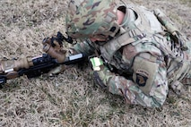 A Soldier from the 2-506, 101st Airborne Division checks his Nett Warrior end user device (EUD) during a full mission test event during a Soldier Touchpoint at Aberdeen Proving Ground, MD in February 2021.