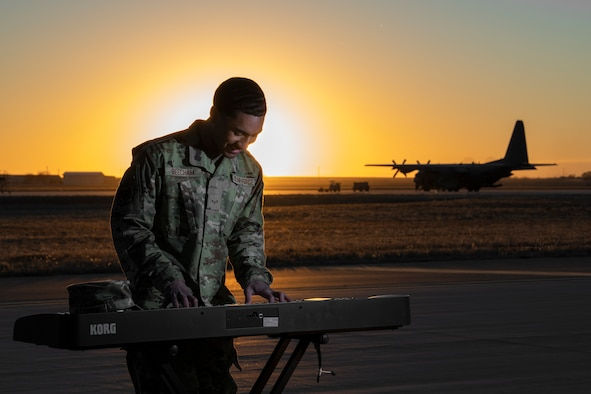 Airman 1st Class Josiah Beecham, 27th Special Operations Aircraft Maintenance Squadron electrical and environmental apprentice, plays the piano on the flightline at Cannon AFB, N.M., February 25th, 2021. Beecham prefers to spend his free time making music as it gives him a creative outlet and a way to engage his mind outside of work. (U.S. Air Force photo by Airman 1st Class Christopher Storer)