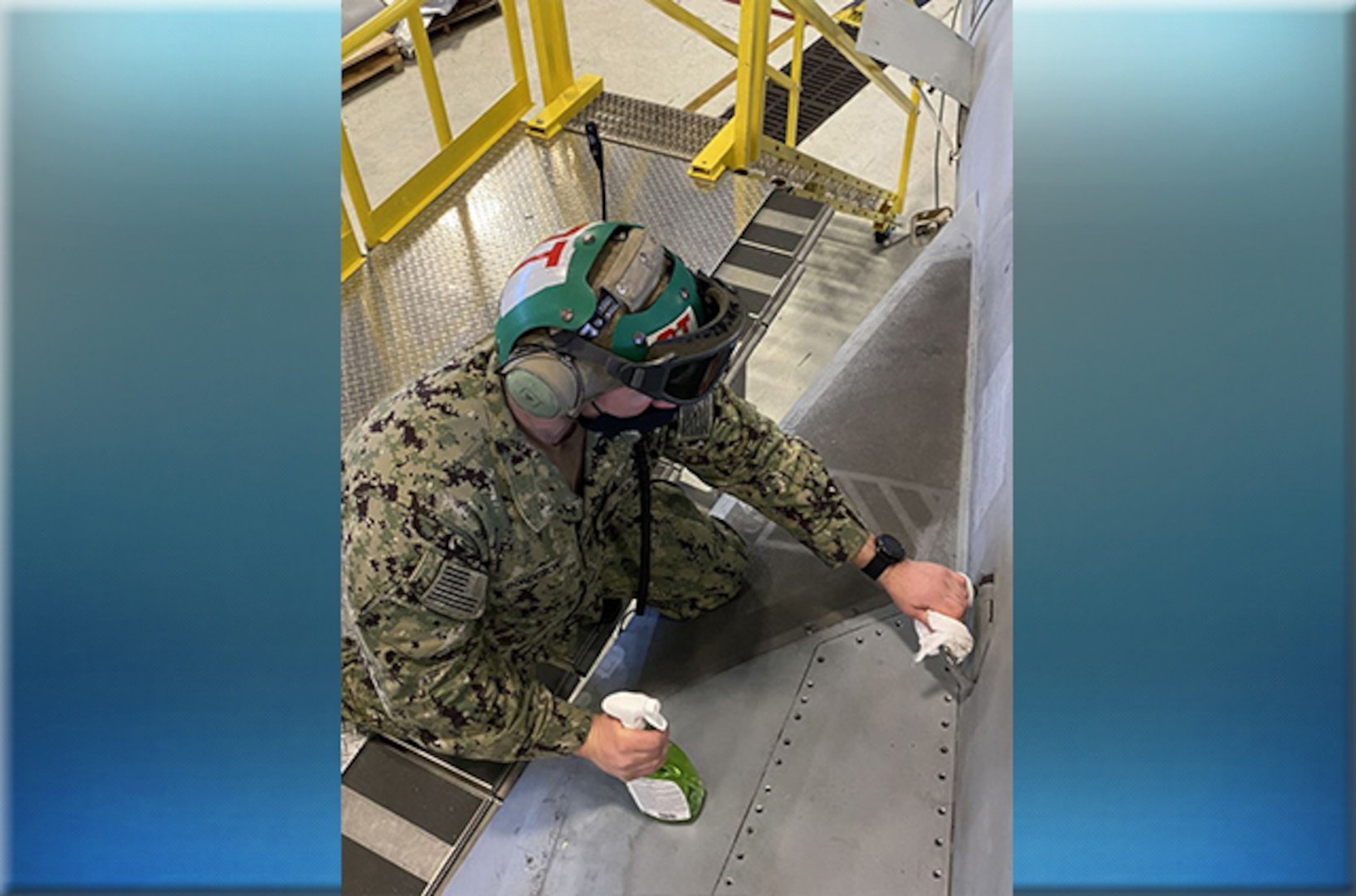 Airman cleans aircraft with disinfectant