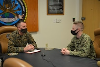 Master Sgt. Robert L. Gallup, Jr speaks with Petty Officer 3rd Class Cullen G. Turner at Navy Expeditionary Logistics Support Group's (NAVELSG) headquarters building on Feb. 24.