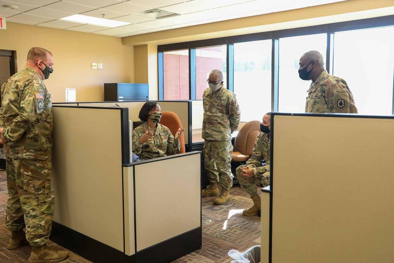 A group of soldiers in an office.