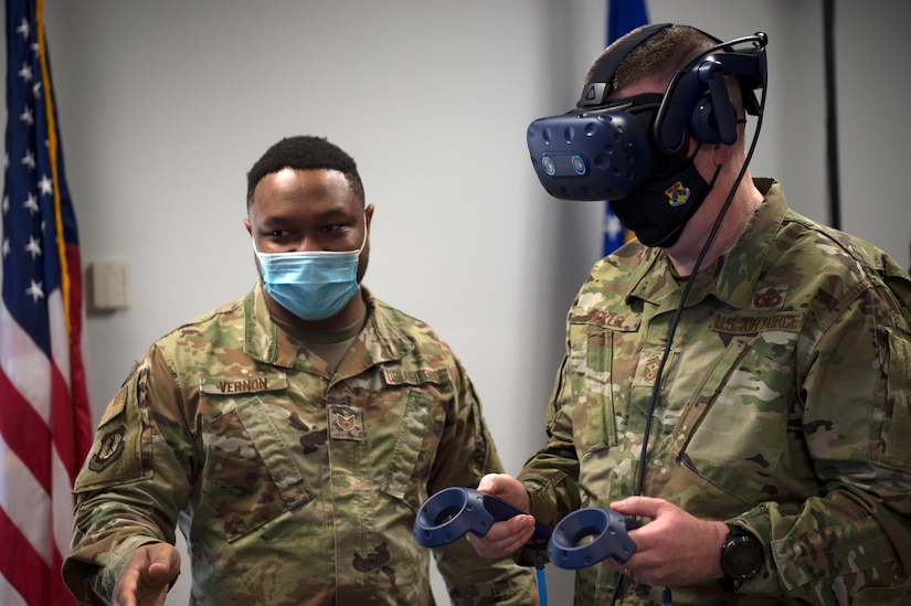 Chief Master Sgt. Chad W. Bickley, 18th Air Force command chief master sergeant, tries out a virtual reality simulation at Joint Base Charleston, S.C., Feb. 25, 2021.
