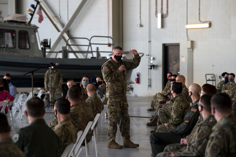Chief Master Sgt. Chad W. Bickley, 18th Air Force command chief master sergeant, briefs during an all call at Joint Base Charleston, S.C., Feb. 25, 2021.