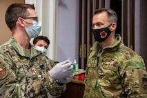 Col. Stephen R. Jones, 432nd Wing/432nd Air Expeditionary Wing commander, receives a briefing about the vaccination procedures at Nellis Air Force Base.