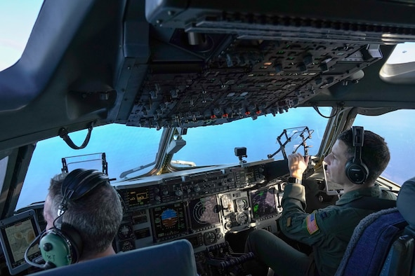 Col. Scott Berndt, 15th Wing Operations Group commander and Capt. Garrison Boone, 535th Airlift Squadron pilot, fly over the Pacific Ocean during a flight training exercise around the Hawaiian Islands, Jan. 31, 2021. The C-17 Globemaster III can perform many different flight maneuvers including tactical airlift and airdrop missions. (Air Force photo by Airman 1st Class Makensie Cooper)