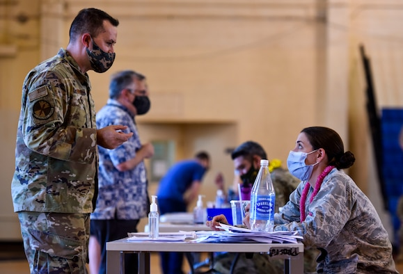 Hickam 15th Medical Group  host the first COVID-19 mass vaccination on Joint Base Pearl Harbor-Hickam, Feb. 9, 2021.  Hawaii Military Medicine has begun providing the COVID-19 vaccine to eligible personnel on a voluntary basis. (U.S. Air Force photo by Tech. Sgt. Anthony Nelson Jr.)