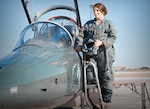 Maj. Vanessa Beaudreault, 12th Flying Training Wing executive officer, steps into the cockpit of a T-38 Talon aircraft February 1, 2021 at Joint Base San Antonio-Randolph. Vanessa previously flew as an instructor pilot with the 560th Flying Training Squadron. (U.S. Air Force photo by Benjamin Faske)