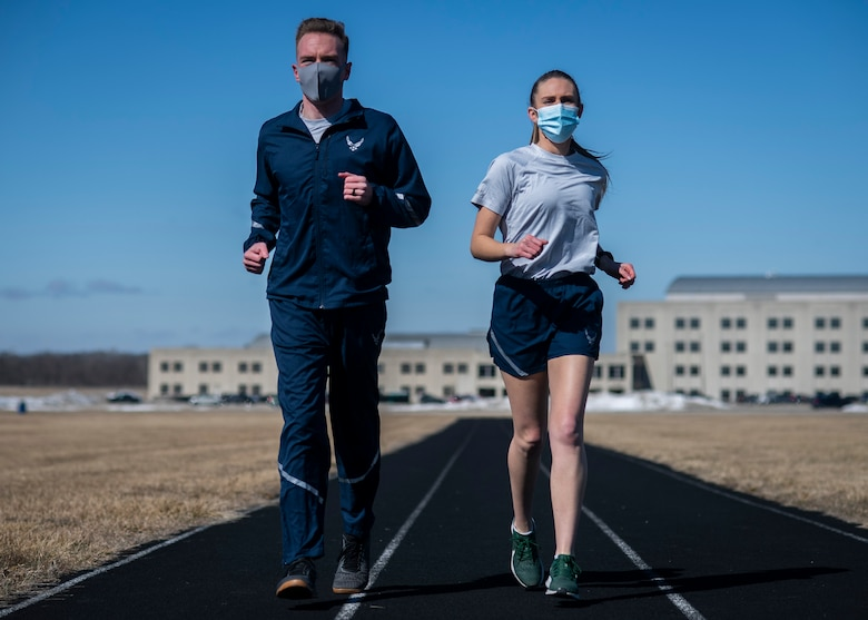 Air Force Uniform Office members 1st Lt. Avery Thomson and 2nd Lt. Maverick Wilhite put updated versions of the Air Force physical training (PT) uniform through their paces at Wright-Patterson Air Force Base, Ohio, Feb. 25, 2021.  The Air Force Uniform Office is part of the Human System's Division in the Air Force Life Cycle Management Center's Agile Combat Support Directorate. This is the first update to the PT uniform in more than 16 years, and over 150 Airmen participated in testing the new gear. The new ensemble currently consists of a jacket, a pair of pants, a T-shirt and two types of shorts; a lined runner's short and a longer unlined multipurpose short. A long sleeve t-shirt and a hoodie are in development. The ensemble features improved fabrics that are softer and quick drying, and have antimicrobial technology, which helps with moisture and odor control. The new uniform items are entering the production phase and will be available to Airmen sometime in 2022. (U.S. Air Force photo by Jim Varhegyi)