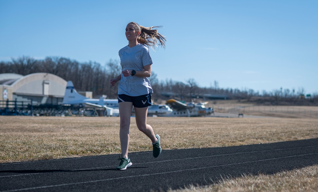 Air Force Uniform Office member 1st Lt. Avery Thomson puts parts of the updated Air Force physical training (PT) uniform through their paces at Wright-Patterson Air Force Base, Ohio, Feb. 25, 2021. The Air Force Uniform Office is part of the Human System's Division in the Air Force Life Cycle Management Center's Agile Combat Support Directorate. This is the first update to the PT uniform in more than 16 years, and over 150 Airmen participated in testing the new gear. The new ensemble currently consists of a jacket, a pair of pants, a T-shirt and two types of shorts; a lined runners short and a longer unlined multipurpose short. A long sleeve t-shirt and a hoodie are in development. The ensemble features improved fabrics that are softer and quick drying, and have antimicrobial technology, which helps with moisture and odor control. The new uniform items are entering the production phase and will be available to Airmen sometime in 2022. (U.S. Air Force photo by Jim Varhegyi)