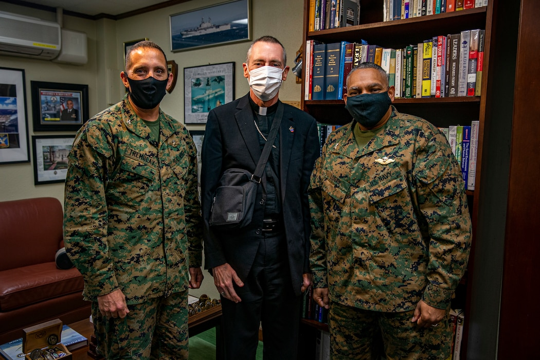 (From left) U.S. Navy Capt. Paul Tremblay, the III Marine Expeditionary Force (MEF) chaplain, Most Reverend William Muhm, auxiliary bishop of the Roman Catholic Archdiocese with the Military Services United States of America, and Capt. John Logan, the command chaplain of Marine Corps Installations Pacific (MCIPAC), pose for a group photo on Camp Foster, Okinawa, Japan, Feb. 26, 2021. Muhm visited Okinawa to meet with III MEF and MCIPAC chaplains and to lead Catholic Confirmation. Muhm will be attending mass at the Camp Foster Chapel on Feb. 26, at 11:45 a.m., and the Camp Courtney Chapel on Feb. 27, at 12:00 p.m. (U.S. Marine Corps photo by Lance Cpl. Alex Fairchild)