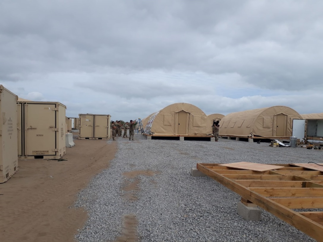 Airmen from the 435th Air Ground Operations Wing and 435th Air Expeditionary Wing execute a short-notice tasker to build-out a base capability in East Africa, Dec. 20, 2020. In addition to the build-out, consolidations and renovations of numerous existing structures were completed to support additional workspaces. (Courtesy photo)
