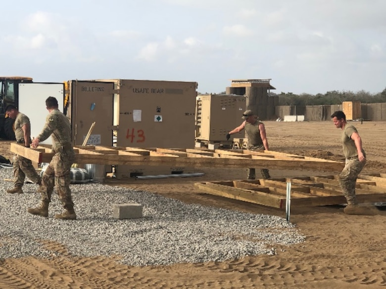 Airmen from the 435th Air Ground Operations Wing and 435th Air Expeditionary Wing execute a short-notice tasker to build-out a base capability in East Africa, Dec. 29, 2020. The teams assigned to the 435th AGOW and 435th AEW successfully executed their short-notice order as one team enabling multi-theater sustainment and support while maintaining partner capacity. (Courtesy photo)