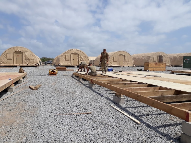 Airmen from the 435th Air Ground Operations Wing and 435th Air Expeditionary Wing execute a short-notice tasker to build-out a base capability in East Africa, Dec. 29, 2020. In addition to the build-out the Airmen repurposed three sleeping buildings into office spaces, expanded kitchen operations by 1,000 square feet, and constructed new fire department berthing tents and an alarm room. (Courtesy photo)