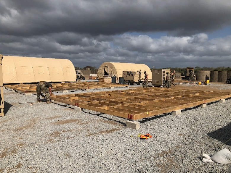 Airmen from the 435th Air Ground Operations Wing and 435th Air Expeditionary Wing execute a short-notice tasker to build-out a base capability in East Africa, Dec. 29, 2020. The Airmen renovated and developed a 3,000 square foot building to consolidate the Base Defense Operations Center, 475th Expeditionary Air Base Squadron Staff and the U.S. Army's Task Force Bayonet security forces into a single joint facility. (Courtesy photo)