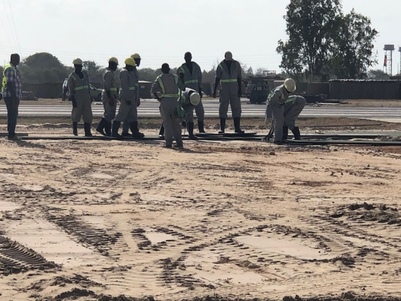 Contractors build helicopter pads to support a base build-out tasker in support of Operation Octave Quartz at a base in East Africa, Dec. 23, 2020. Airmen of the 435th Air Ground Operations Wing and 435th Air Expeditionary Wing took part in the movement of personnel and cargo to support OOQ. (Courtesy photo)