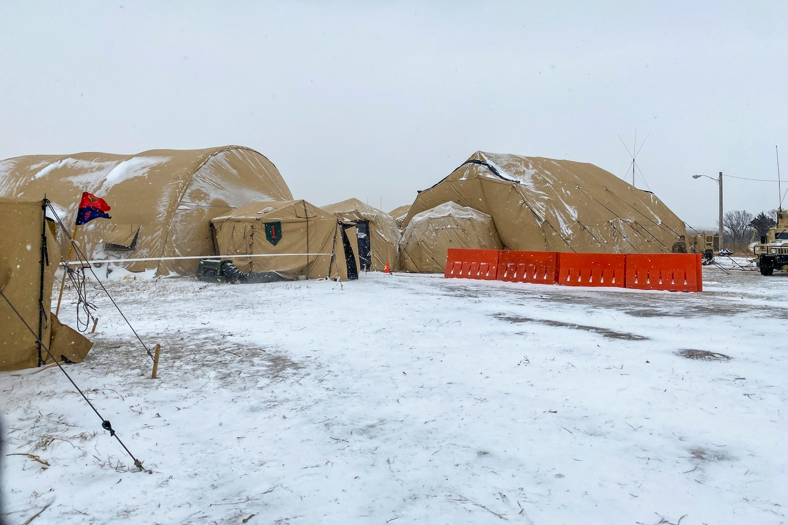 Portable shelters set-up as the tactical operations center during a winter warfighter exercise Jan. 26-Feb. 14, 2021 at Fort Riley, Kansas. Nearly 200 Soldiers from the Nebraska Army National Guard's Headquarters and Headquarters Company, 67th Maneuver Enhancement Brigade and the 234th Signal Company, attended the three-week training exercise that tested their ability to operate in a simulated combat environment in support of the 1st Infantry Division.