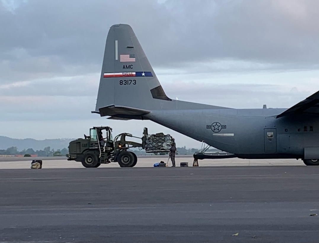 U.S. Air Force Airmen assigned to the 435th Air Expeditionary Wing load a U.S Air Force C-130J Super Hercules aircraft during Operation Octave Quartz