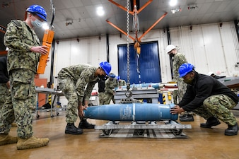 Sailors assigned to Navy Munitions Command East Asia Division (NMC EAD) Unit Misawa, downgrade inert MK 62 Quickstrike mines during quarterly training.
