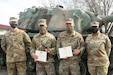 The 642nd Regional Support Group announced the winners of its annual Best Warrior Competition at Fort McClellan, Ala., Feb. 24, 2021. U.S. Army Spc. Omid A. Skinner with 441st Transportation Company and Sgt. 1st Class Adam Smith of the 145th Theater Movement Control Element received top honors after four days of intense challenges, including a seven-mile ruck march, land navigation course and rifle marksmanship. Skinner earned top enlisted Soldier and Smith was the top NCO out of the competitors. Both will represent the brigade at the 143rd Sustainment Command (Expeditionary) Best Warrior Competition. Spc. Joshua R. Fox of the 441st Transportation Company and Staff Sgt. Manuel F. Valencia of the 287th Transportation Company were selected as runners-up and will take the winners' places if they are unable to attend the next level of competition. Pictured, from left, 642nd RSG Commander Col. Robert J. Coker, Smith, Skinner and Command Sgt. Maj. Denise Demps. (U.S. Army photo by Sgt. 1st Class Gary A. Witte, 642nd Regional Support Group)
