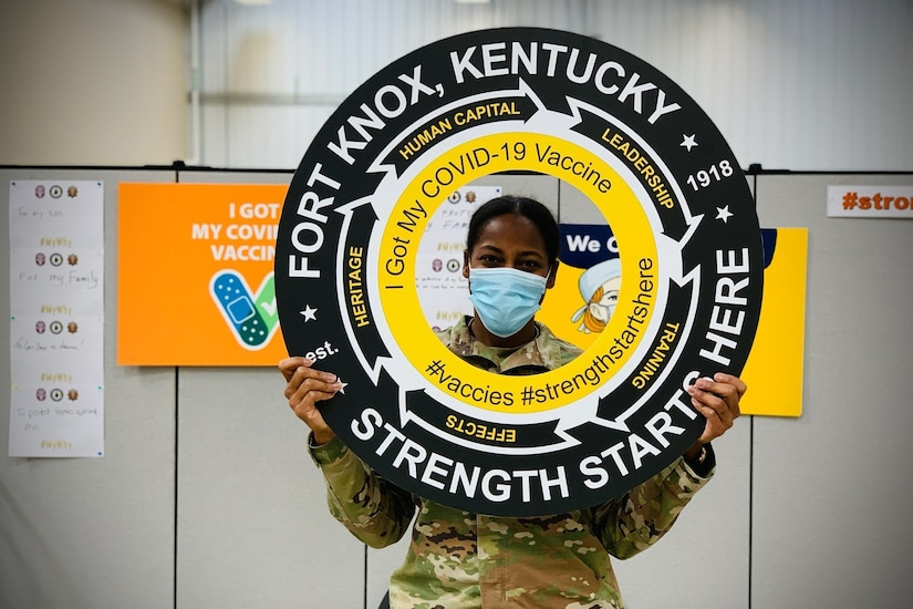 A soldier holds up a sign.