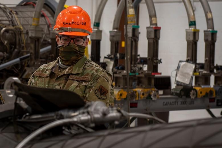 Senior Airman Derrick Radzieski, 4th Component Maintenance Squadron aerospace propulsion technician, inspects an F-15E Strike Eagle engine at Seymour Johnson Air Force Base, North Carolina, Feb. 2, 2021.