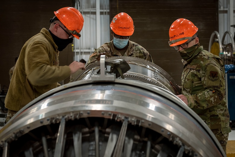 Aerospace propulsion technicians from the 4th Component Maintenance Squadron work on an F-15E Strike Eagle engine at Seymour Johnson Air Force Base, North Carolina, Feb. 2, 2021.