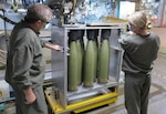 Thales Australia employees fill M795 155mm high-explosive projectiles at the Benalla Munitions Manufacturing Plant in Victoria, Australia.