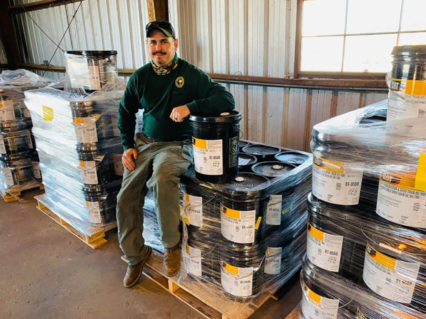 Equipment & Fleet Manager Doug Mills accepts 162 five-gallon cans of excess hydraulic oil from Marine Corps Base Camp Lejeune, North Carolina, to support the South Carolina Forestry Commission's Caterpillar D4K2 Firefighting Dozers.