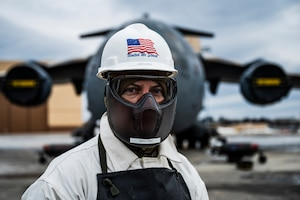 Master Sgt. Matt Dillon, 911th Aircraft Maintenance Squadron crew chief, poses for a photo after servicing the liquid oxygen of a C-17 Globemaster III at the Pittsburgh International Airport Air Reserve Station, Pennsylvania, Feb. 23, 2021.