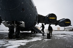 Airmen assigned to the 911th Aircraft Maintenance Squadron prepare to conduct routine maintenance on a C-17 Globemaster III at the Pittsburgh International Airport Air Reserve Station, Pennsylvania, Feb. 16, 2021.