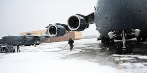 Master Sgt. Timothy Schurr, 911th Aircraft Maintenance Squadron guidance and controls technician, pulls a power cord from a generator to a C-17 Globemaster III in order to conduct routine maintenance at the Pittsburgh International Airport Air Reserve Station, Pennsylvania, Feb. 16, 2021.