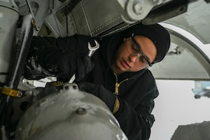 Senior Airman Kendra Ancell, hydraulics technician with the 911th Aircraft Maintenance Squadron, conducts routine maintenance on the landing gear strut of a C-17 Globemaster III at the Pittsburgh International Airport Air Reserve Station, Pennsylvania, Feb. 1, 2021.
