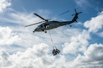 U.S. Marines with Combat Logistics Regiment 3 (CLR-3), 3d Marine Logistics Group (MLG), and Navy Sailors with the USS Theodore Roosevelt (CVN 71) Beach Detachment Group conduct external lifts with a SH-70 Seahawk with Helicopter Sea Combat Squadron 8 for a vertical replenishment of the aircraft carrier USS Theodore Roosevelt, Naval Base Guam, Feb. 25, 2021.  3d MLG, based out of Okinawa, Japan, is a forward deployed combat unit that serves as III Marine Expeditionary Force's comprehensive logistics and combat service support backbone for operations throughout the Indo-Pacific area of responsibility. (