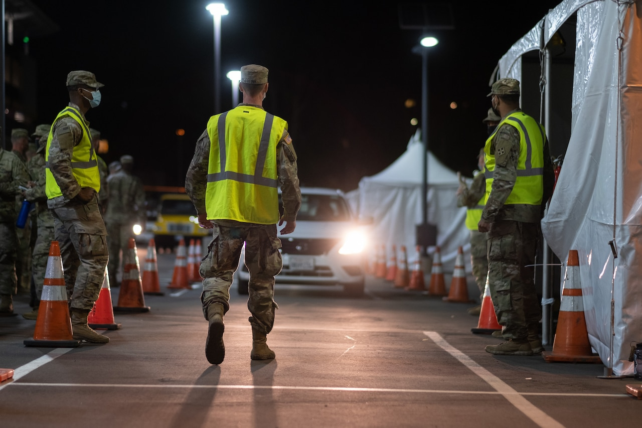 Soldiers direct traffic.