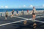 Members of the USCGC Stone (WMSL 758) conduct a regular workout while at sea in the South Atlantic on Jan. 19, 2021. Maintaining physical fitness is key to performing operations safely. (U.S. Coast Guard photo by Petty Officer 3rd Class John Hightower)