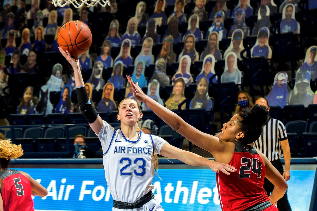 A U.S. Air Force Academy basketball player shoots a layup during a game.