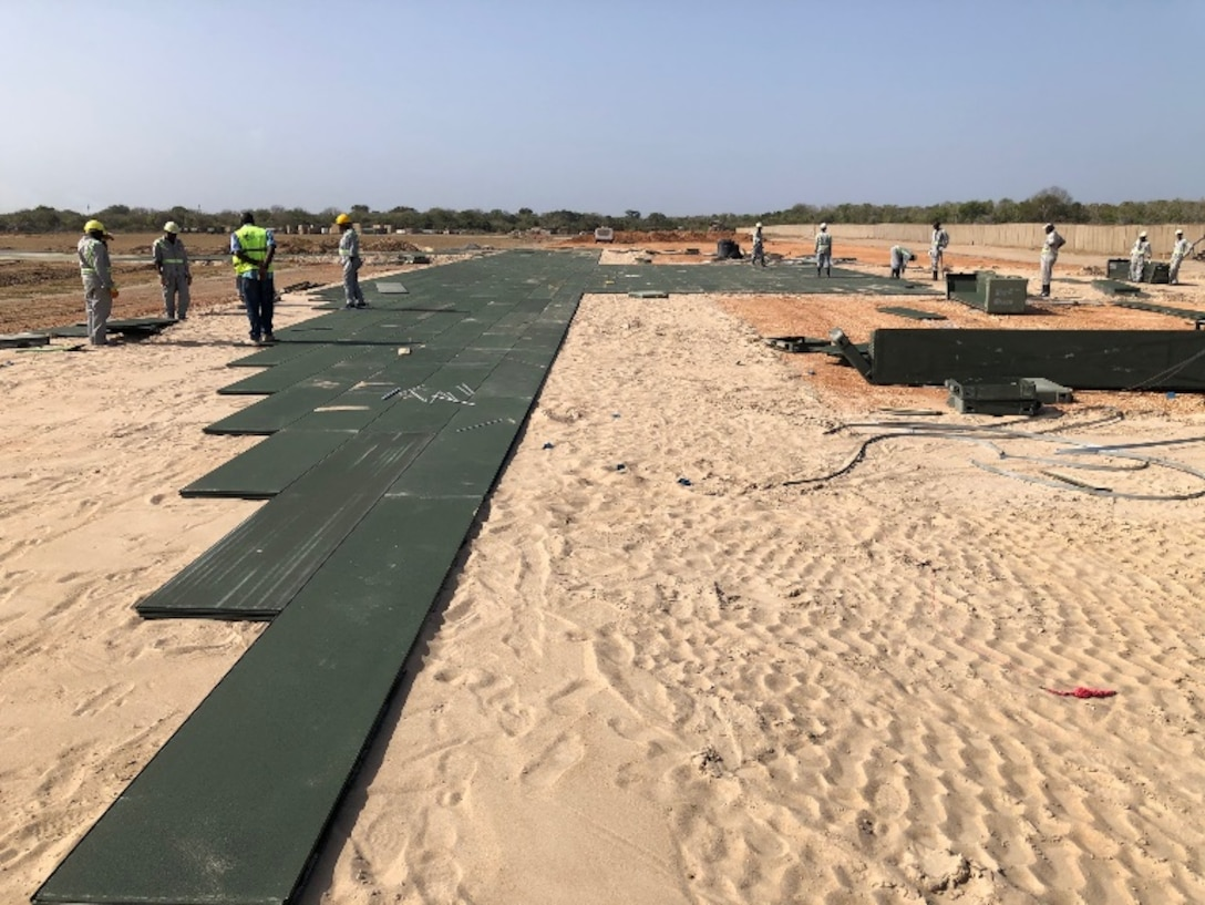 Contractors build helicopter pads to support a base build-out tasker in support of Operation Octave Quartz at a base in East Africa, Dec. 23, 2020. The objective of OOQ was to re-posture assets and personnel within Somalia to other locations within the region at the direction of the president of the United States and the acting secretary of defense.