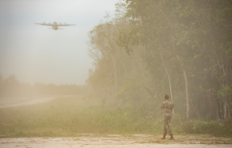 A U.S. Air Force C-130J Super Hercules, assigned to Yokota Air Base, Japan, kicks up a cloud of dust after taking off from a rocky landing zone during Cope North 21, Feb. 11, 2021, on Angaur, Palau.