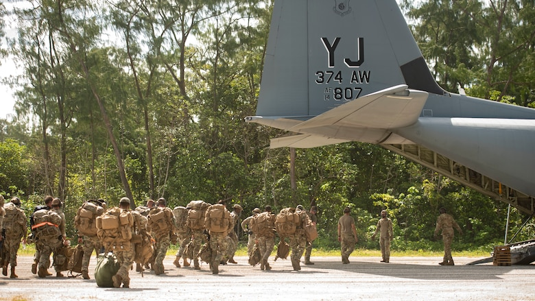 U.S. Air Force defenders from the 736th Security Forces Squadron, assigned to Andersen Air Force Base, Guam, board a C-130J Super Hercules, assigned to Yokota Air Base, Japan, during Cope North 21, Feb. 11, 2021, on Angaur, Palau.