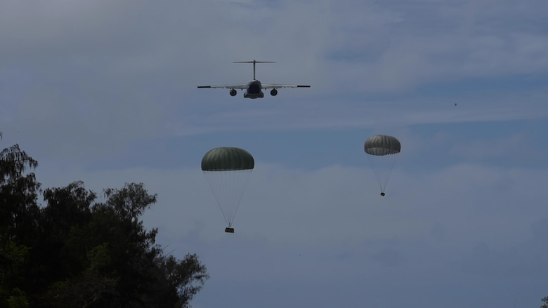 A Koku-Jieitai Kawasaki C-2, assigned to the 403rd Squadron from Miho Air Base, airdrops two packages during Cope North 21, Feb. 11, 2021, on Angaur, Palau.