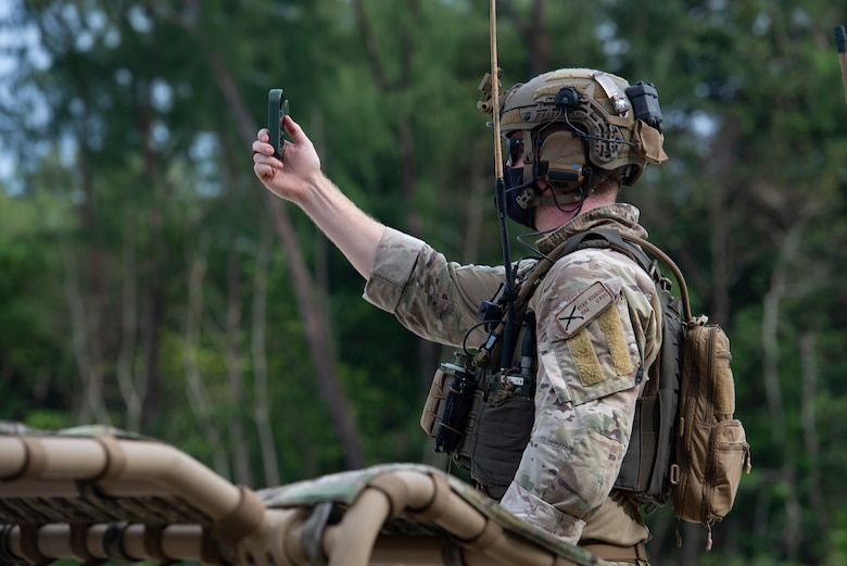 U.S. Air Force Major Ryan Kiggins, 736th Security Forces Squadron commander, checks wind speeds before an airdrop during Cope North 21, Feb. 10, 2021, on Angaur, Palau.