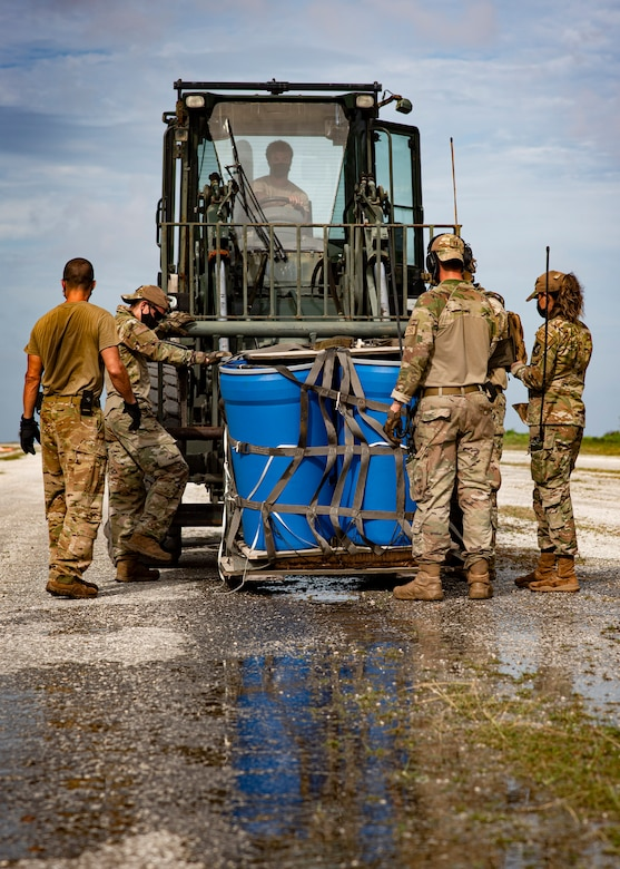U.S. Air Force Airmen assigned to the 36th Contingency Response Group secure an airdropped package to a forklift to be transported during Cope North 21, Feb. 10, 2021, on Angaur, Palau.