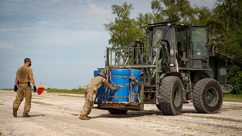 U.S. Air Force Staff Sgt. Vincent Simmons, 36th Contingency Response Squadron aerial port journeyman, secures an airdroped package to a forklift during Cope North 21, Feb. 10, 2021, on Angaur, Palau.