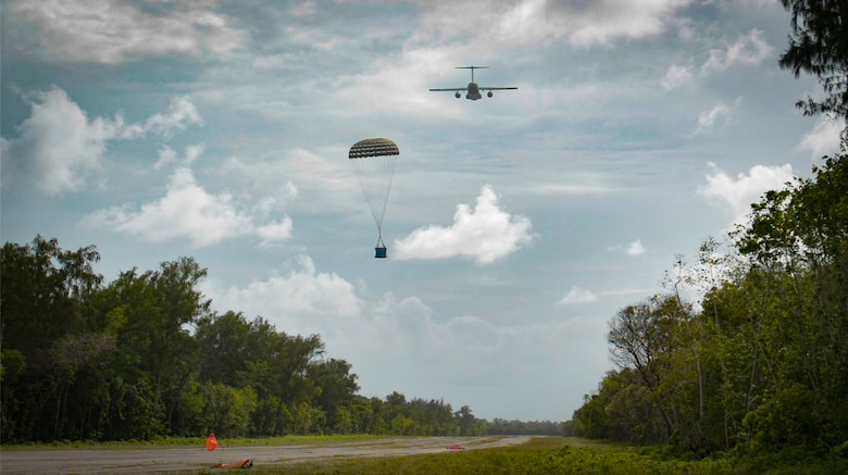 A Koku-Jieitai Kawasaki C-2, assigned to the 403rd Squadron from Miho Air Base, airdrops a package during Cope North 21, Feb. 10, 2021, on Angaur, Palau.