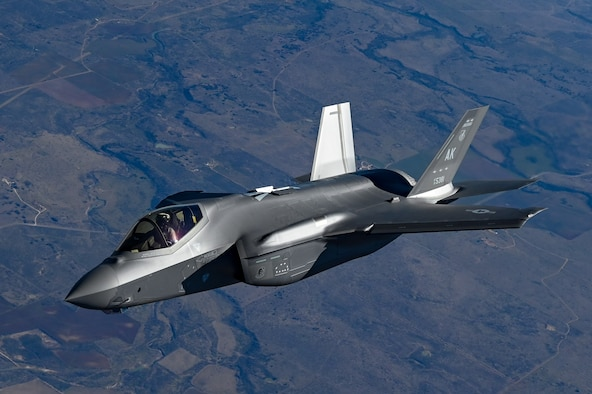 An F-35 Lightning II from the Defense Contract Maintenance Agency conducts its first flight and first tanking with a KC-135R Stratotanker from the 465th Air Refueling Squadron, Tinker Air Force Base, Oklahoma, Feb. 24, 2021. Once fully tested this F-35 will join the fleet at Eielson Air Force Base, Alaska. (U.S. Air Force photo by Senior Airman Mary Begy)